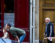 Careful with that loaf now. Father and son, and old man with loaf of bread, Île Saint-Louis, Paris