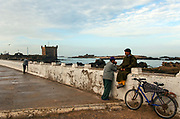 The Port of Essaouira lies on a strategic point of the Moroccan coastline. Its harbour is the scene of constant activity with fishing boats in dry dock, fishermen mending their nets and selling their catches at dawn. It is a UNESCO world heritage site