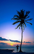 Woman viewing sunset, Ambergris Caye, Belize