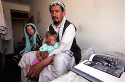KABUL 06 August 2005..Shabana with her father and sister wait for the 2pm appoiment at Maiwand Hospital