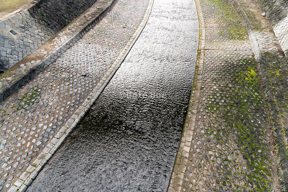 artificial stream flowing under a bridge Kyoto Japan