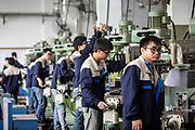 Workers operate machinery on the assembly line at a Lyric Robot factory, operated by Guangdong Li Yuanheng Intelligent Automation Co., in Huizhou, Guangdong province, China, on Monday, April 18, 2016. Once synonymous with Chinas manufacturing might, as the days of cheap land and labor recede, the provinces businesses are in a race to upgrade or move.
