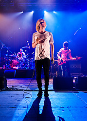 "© Licensed to London News Pictures. 08/06/2012. London, UK. The Charlatans perform live at Hammersmith Apollo, playing their 1997 and fifth studio album ""Telling' Stories"" in its entirety.  In this photo - Jon Brookes, Tim Burgess, Mark Collins.  Photo credit : Richard Isaac/LNP"