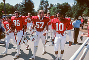COLLEGE FOOTBALL:  The Stanford football teams walks to the stadium before a game in October 1982 at Stanford Stadium in Palo Alto, California.  Visible players include Mike Teeuws #57, Andre Tyler #10, Greg Baty #84, Mark Harmon #8, Kevin Bates #86.  Photograph by David Madison ( www.davidmadison.com ).