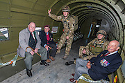 Tom Walsh,88 Glider Rgt, Cecil Hughs, 9 Para, Sgt Allen Jackson, 3 Para, Nick Quin, 2 Para and Geoff Patinson, 90, 9 Para. inside a dakota. Veterans of the Parachute Regiment at the time of D Day, in the second world war, visit 16 Air Assault Brigade who will be carrying out a drop to commemorate the 70th anniversary next week. Colchester, UK.