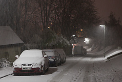 Licensed to London News Pictures. 12/01/2017. Caterham, UK.  Cars covered in snow are seen on a residential road in Caterham, UK, today (12/01/2017). Photo credit: Matt Cetti-Roberts/LNP