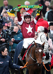 Jockey Keith Donoghue celebrates his victory in the Glenfarclas Chase on Tiger Roll during Ladies Day of the 2019 Cheltenham Festival at Cheltenham Racecourse.
