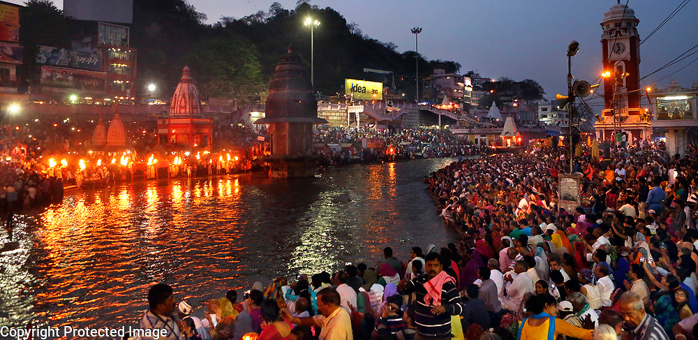 The sights and sounds of the daily Aarti ceremony fill the air as thousands line the Ganges River at Hari ki Pari in Haridwar, India.<br /> Photo by Shmuel Thaler <br /> shmuel_thaler@yahoo.com www.shmuelthaler.com
