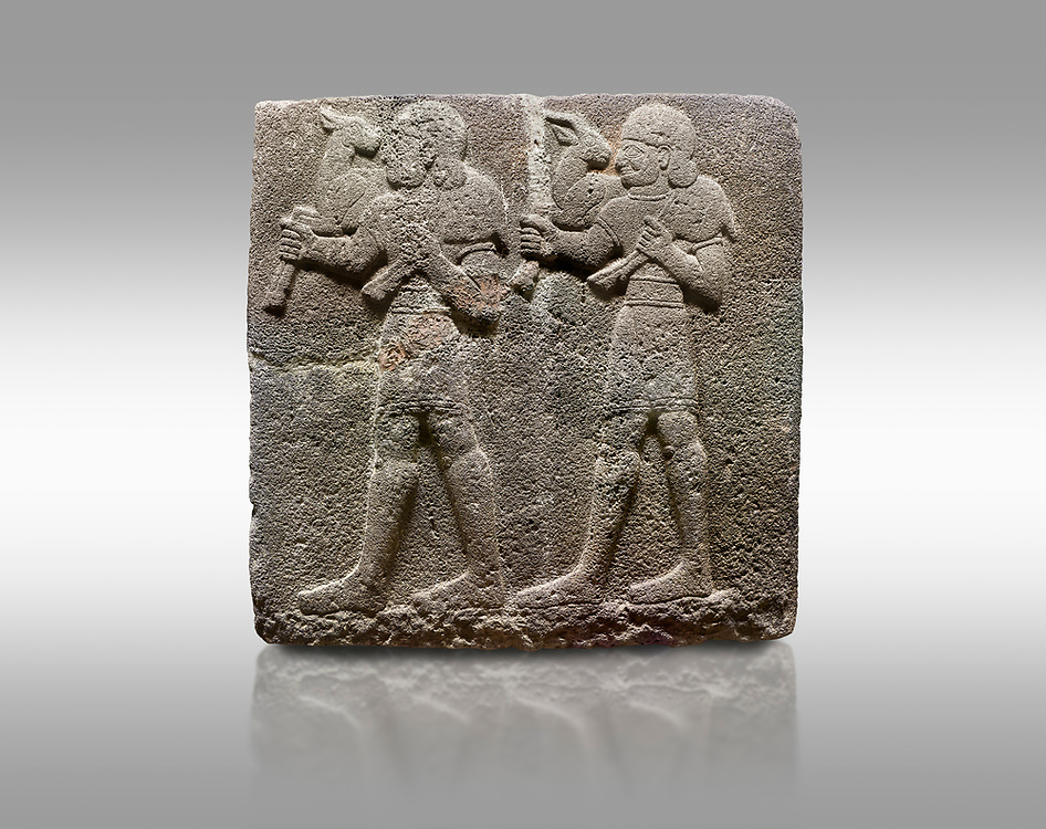 Picture & image of Hittite monumental relief sculpted orthostat stone panel of a Procession Basalt, Karkamıs, (Kargamıs), Carchemish (Karkemish), 900-700 B.C.  Anatolian Civilisations Museum, Ankara, Turkey. Young male servants of Kubaba while carrying sacrificial animals on their shoulders. <br /> <br /> Against a gray background. .<br />  <br /> If you prefer to buy from our ALAMY STOCK LIBRARY page at https://www.alamy.com/portfolio/paul-williams-funkystock/hittite-art-antiquities.html  - Type  Karkamıs in LOWER SEARCH WITHIN GALLERY box. Refine search by adding background colour, place, museum etc.<br /> <br /> Visit our HITTITE PHOTO COLLECTIONS for more photos to download or buy as wall art prints https://funkystock.photoshelter.com/gallery-collection/The-Hittites-Art-Artefacts-Antiquities-Historic-Sites-Pictures-Images-of/C0000NUBSMhSc3Oo