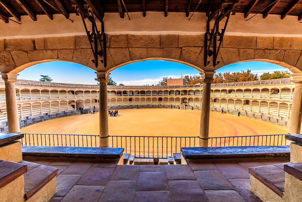 The Plaza de Toros in Ronda, Spain. The Ronda bullring is one of the most significant and oldest bullrings in the world. It is famous for the Romero and Ordoñez dynasties and the museum to bullfighting. Covered with a two-sided Arab bricks roof, the bullrings elegance is unsurpassed in Spain.