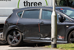 © Licensed to London News Pictures. 28/05/2018. Stockport, UK. A damaged Seat car at the scene outside The Salisbury Club on Truro Avenue in the Brinnington area of Stockport, Greater Manchester, where a car collided with pedestrians late last night, killing one man and injuring others.  A murder investigation has been launched. Police later recovered a black Audi A4 which fled the scene. Photo credit: Joel Goodman/LNP