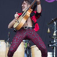 Lead vocalist Eugene Hutz of Ukraine plays a guitar on a concert with American punk band Gogol Bordello performing on the Main stage of Sziget Festival held in Budapest, Hungary on Aug. 14, 2018. ATTILA VOLGYI