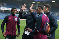 Aston Villa players have a laugh and joke on the Loftus Road pitch as they arrive for the match.  EFL Skybet championship match, Queens Park Rangers v Aston Villa at Loftus Road Stadium in London on Sunday 18th December 2016.<br /> pic by Steffan Bowen, Andrew Orchard sports photography.
