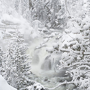 Firehole Falls emits steam as the Firehole River churns through a tight spot in the canyon. Yellowstone National Park, Wyoming