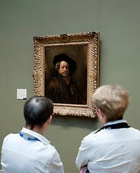 Visitors looking at Self portrait by Rembrandt van Rijn at Metropolitan Museum of Art in Manhattan , New York City, USA