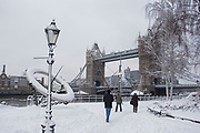 Heavy overnight snowfall covers London in a thick blanket of fine snow. The heaviest snowfall in decades. Snow covered sculptures on the approach to Tower Bridge on the nort side of the river.