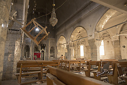 October 23, 2016 - Bartella, Nineveh, Iraq - A chapel in the Mart Shmony Church, ransacked by Islamic State militants, is seen in the Iraqi town of Bartella...Bartella, a mainly Christian town with a population of around 30,000 people before being taken by the Islamic State in August 2014, was captured two days ago by the Iraqi Army's Counter Terrorism force as part of the ongoing offensive to retake Mosul. Although ISIS militants were pushed back a large amount of improvised explosive devices are still being found in the town's buildings. (Credit Image: © Matt Cetti-Roberts/London News Pictures via ZUMA Wire)