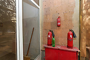 """Three expired fire extinguishers are seen at the entry of the previously abandoned building of """"SOVIET Hotel"""" in Metsamor on Tuesday, Dec 28, 2020. """"SVOIET Hotel"""" is now filled with internally displaced people from Nagorno Karabakh in Metsamor. According to government statistics, there are 192 000 internally displaced people in Armenia. This figure covers displacement due to a variety of causes. However, according to IOM (International Organisation for Migration) as of Dec 2020 - an estimated 92 639 people alone were displaced as a result of military operations in areas bordering Azerbaijan due to the 44 days of war over the region of Nagorno-Karabakh. (Photo/ Vudi Xhymshiti)"""