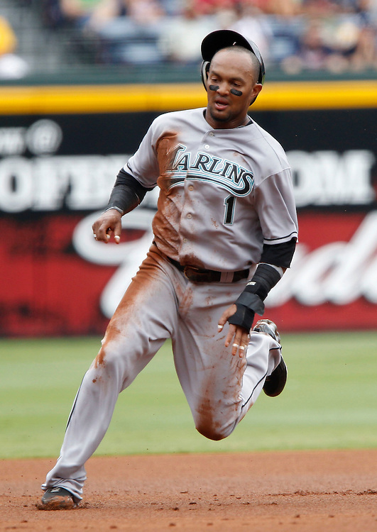 ATLANTA - AUGUST 29:  Centerfielder Emilio Bonifacio #1 of the Florida Marlins runs to third base during the game against the Atlanta Braves at Turner Field on August 29, 2010 in Atlanta, Georgia.  The Braves beat the Marlins 7-6.  (Photo by Mike Zarrilli/Getty Images)