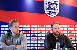 England's Harry Kane (left) and manager Gareth Southgate during the press conference at The Grove Hotel, Hertfordshire.