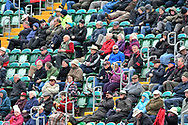 The fans in the Marcus Trescothick Stand wearing thick coats on a cold day during the third day of the Specsavers County Champ Div 1 match between Somerset County Cricket Club and Yorkshire County Cricket Club at the Cooper Associates County Ground, Taunton, United Kingdom on 29 April 2018. Picture by Graham Hunt.