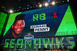 April 26, 2018 - Arlington, TX, U.S. - ARLINGTON, TX - APRIL 26:  Rashaad Penny on the video board after being chosen by the Seattle Seahawks with the 27th pick during the first round at the 2018 NFL Draft at AT&T Statium on April 26, 2018 at AT&T Stadium in Arlington Texas.  (Photo by Rich Graessle/Icon Sportswire) (Credit Image: © Rich Graessle/Icon SMI via ZUMA Press)
