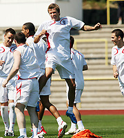 Photo: Chris Ratcliffe.<br />England Training Session. FIFA World Cup 2006. 13/06/2006.<br />David Beckham has a laugh during training.