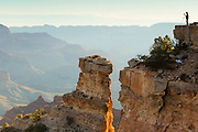 A lone photographer captures the beauty of the Grand Canyon on a cold winter morning.