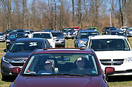 Parishioners sit in their cars as Bethany Wesleyan Church holds Sunday worship service Mar. 22, 2020, at Becky's Drive-In in Walnutport, Pennsylvania. Concerns over the coronavirus have closed churches in an effort to avoid gatherings of large crowds.