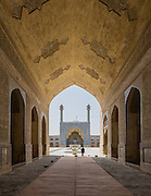 South-side Iwan seen from North-side arch. Jameh Mosque aka The Congregational Mosque of Isfahan built from 771 to the end of the 20th century. Isfahan, Iran