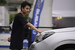 August 5, 2017 - Bangkok, Bangkok, Thailand - Competitors participate in the Subaru Palm Challenge Thailand 2017 in Bangkok, Thailand, on August 5, 2017.  Subaru Palm Challenge Thailand 2017 at Cental World, Bangkok The competition requires participants to keep a hand on a pre-specified position on a car for as long as possible, with a five-minute break every six hours. for top 10 finalist for an all trip to Singapore on 28th - 31st Oct 2017, and stand a chance to win a new Subaru Forester worth THB 1.398 MB. (Credit Image: © Anusak Laowilas/NurPhoto via ZUMA Press)