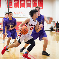 Isaiah Johnson (15) of Grants drives near the baseline past Jordan Heslop (23) of Kirtland Central at the Eddie Pena Classic in Grants on Friday. Grants won 60-42.