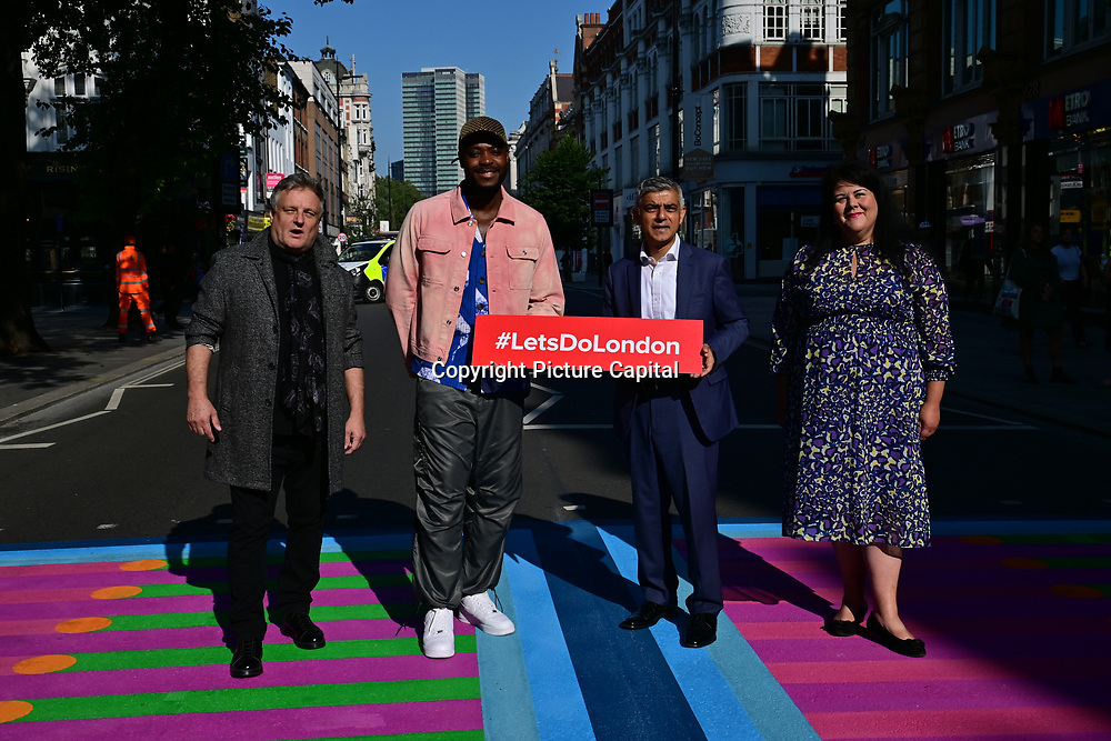 Photographer Rankin, artist Yinka Ilori and The Mayor of London, Sadiq Khan attended Let's Do London Autumn culture season with spectacular public street art installations. Joined by artist Yinka Ilori, and photographer Rankin to unveil Bring London Together – a spectacular new public art commission transforming 18 pedestrian crossings with distinctive playful designs using a bright colour pallet and bold forms. The 'Bring London Together'  at Tottenham Court Road on 2021-09-16 London, UK.