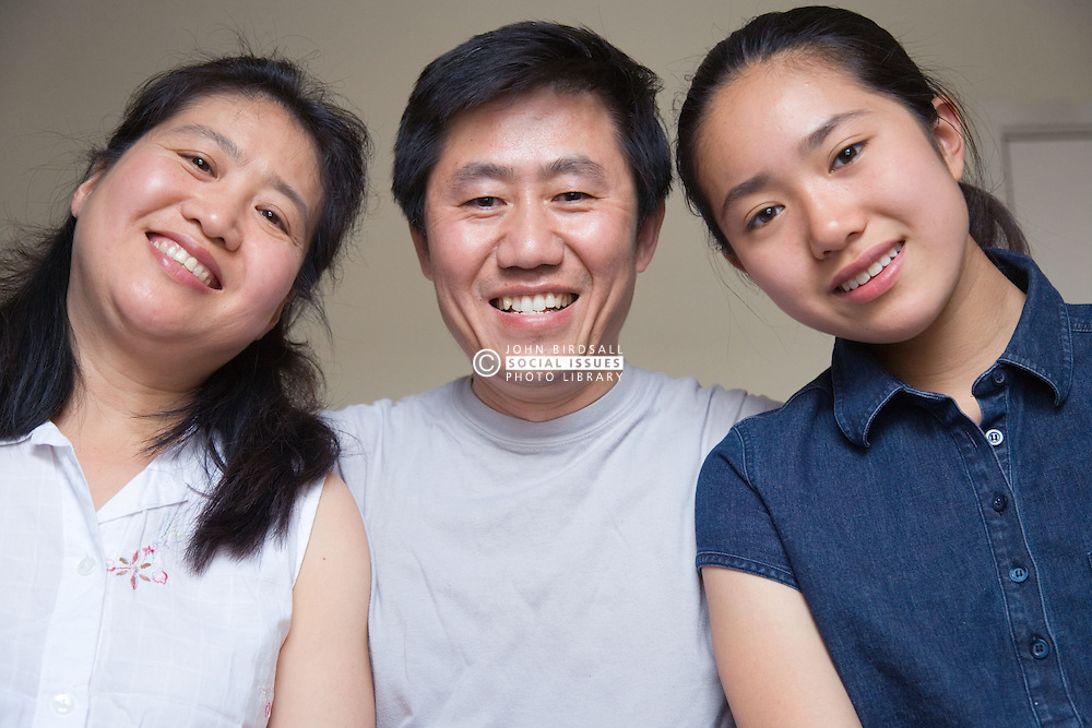 Portrait of mother; father and daughter together,