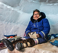 Anna Ohaituk, a inuit woman that i've met while i was visiting an igloo. She was sharing the bannick with the visitors. She is a culture teacher at Innalik school.