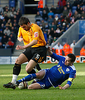 Photo: Steve Bond/Richard Lane Photography. <br />Leicester City v Hull City. Coca Cola Championship. 21/03/2008. Simon Walton (L) is tackled by Matt Oakley (R)