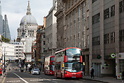 View with buses along Fleet Street looking towards the St Pauls Cathedral in London, England, United Kingdom.