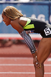 Sanya Richards-Ross, Women's 400 meters, champion, Olympian, rests on knees after winning