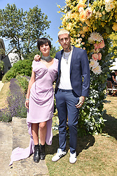 Eliza Cummings and Miles Langford at the 'Cartier Style et Luxe' enclosure during the Goodwood Festival of Speed, Goodwood House, West Sussex, England. 15 July 2018.