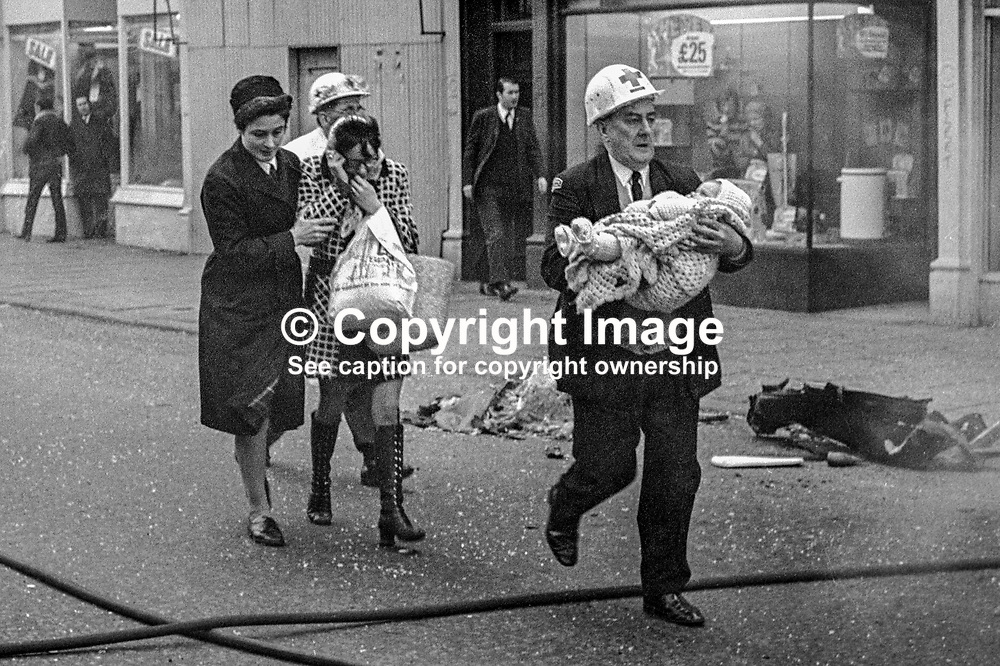 An ambulanceman carries an injured child from the scene of a Provisional IRA car bomb explosion in Bradbury Place, Belfast, N Ireland. An off-duty nurse and a paramedic escort the child's distraught mother. 197201210021b.<br /> <br /> Copyright Image from Victor Patterson, Belfast, UK<br /> <br /> t: +44 28 9066 1296 (from Rep of Ireland 048 9066 1296)<br /> m: +44 7802 353836<br /> e: victorpattersonbelfast@gmail.com<br /> <br /> www.images4media.com<br /> <br /> Please see my full Terms and Conditions of Use at https://www.images4media.com/p/terms-conditions - it is IMPORTANT that you familiarise yourself with them.<br /> <br /> Images used online incur an additional cost. This cost should be agreed in writing in advance. Online images must be visibly watermarked i.e. © Victor Patterson or that of the named photographer within the body of the image. The original metadata must not be deleted from images used online.<br /> <br /> This image is only available for the use of the download recipient i.e. television station, newspaper, magazine, book publisher, etc, and must not be passed on to a third party. It is also downloaded on condition that each and every usage is notified within 7 days to victorpattersonbelfast@gmail.com.<br /> <br /> The right of Victor Patterson (or the named photographer) to be identified as the author is asserted in accordance with The Copyright Designs And Patents Act (1988). All moral rights are asserted.