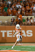 AUSTIN, TX - AUGUST 30:  Nick Rose #23 of the Texas Longhorns kicks off against the North Texas Mean Green on August 30, 2014 at Darrell K Royal-Texas Memorial Stadium in Austin, Texas.  (Photo by Cooper Neill/Getty Images) *** Local Caption *** Nick Rose