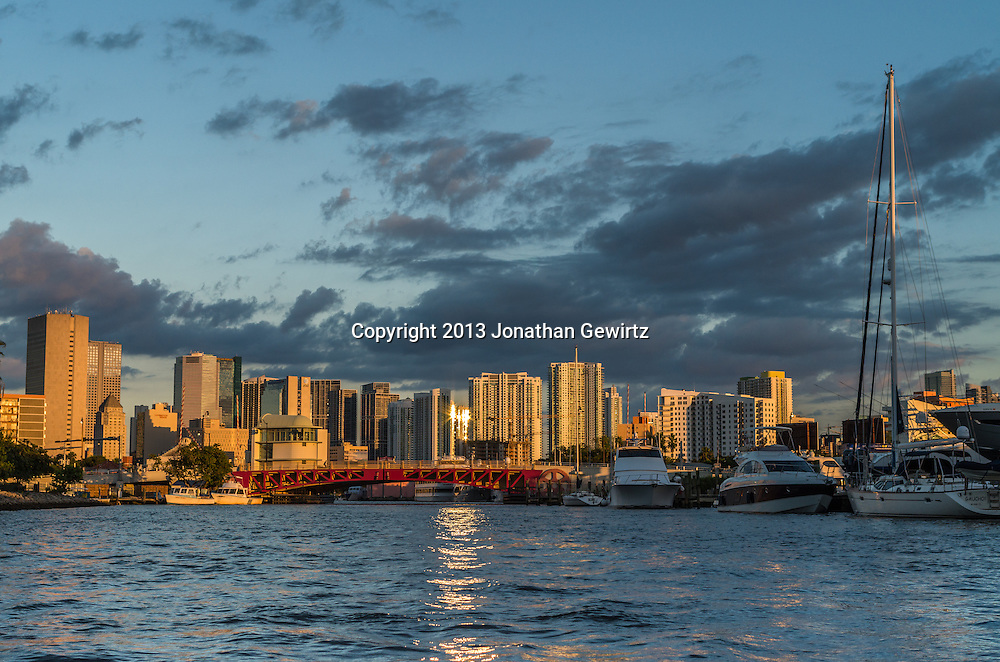 Boats and infrastructure on the Miami River looking east around sunset in the direction of downtown Miami, Florida. WATERMARKS WILL NOT APPEAR ON PRINTS OR LICENSED IMAGES.