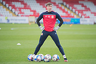 Stevenage goalkeeper Billy Johnson (13) stands over the balls in a warm up before the EFL Sky Bet League 2 match between Stevenage and Morecambe at the Lamex Stadium, Stevenage, England on 6 February 2021.