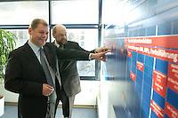 12 JAN 2004, BERLIN/GERMANY:<br /> Olaf Scholz (L), SPD Generalsekretaer, und Martin Schulz (R), SPD Spitzenkandidat, am uebergrossen Terminplan waehrend einer Besichtigung  der SPD Europa Kampa, Wahlkampfzentrale fuer die Wahl des Europaeischen Parlamentes, anlaesslich der Eroeffnung des Wahlkampfes, Willy-Brandt-Haus<br /> IMAGE: 20040112-02-050<br /> KEYWORDS: Eröffnung, Eroeffnung