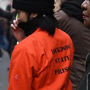 London March 20th 2021 , A protestor wearing an orange jacket written Lockdown State Prison. 2021-03-20