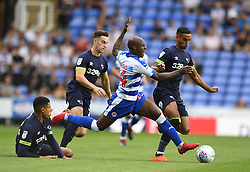 Reading's Sone Aluko and Derby County's Max Lowe (right) battle for the ball