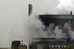 © Licensed to London News Pictures. 27/02/2012. Tilbury, UK. Smoke rising from a blaze at Tolbury power station in Essex, in areas containing about 4,000 tonnes of wood pellets. The  blaze at Tilbury Power Station in the Thames estuary began just before 08:00 am this morning (27/02/2012) and quickly engulfed the building in smoke. Photo credit : Grant Falvey/LNP