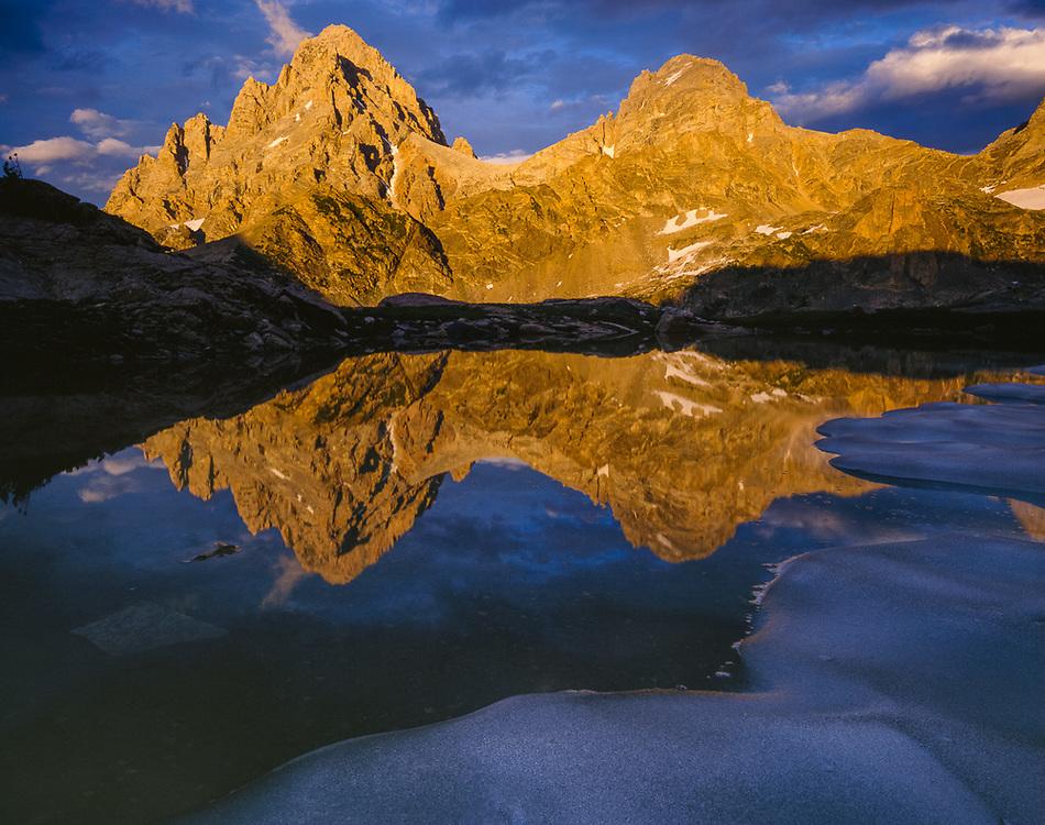 Grand Teton and Mount Teewinot, alpine tarn, evening light, July, Grand Teton National Park, Wyoming, USA