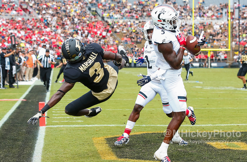 WEST LAFAYETTE, IN - SEPTEMBER 10: As Bilal Marshall #3 of the Purdue Boilermakers falls to the ground Mike Tyson #5 of the Cincinnati Bearcats makes an interception in the end zone at Ross-Ade Stadium on September 10, 2016 in West Lafayette, Indiana.  (Photo by Michael Hickey/Getty Images) *** Local Caption *** Bilal Marshall; Mike Tyson