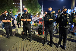 "© Licensed to London News Pictures; 26/09/2020; Bristol, UK. Police stop a band busking and disperse a crowd of people who had gathered to listen in the city centre after the 10pm curfew early closing of pubs and bars. The band said they had asked the crowd to socially distance. This is the first weekend of the 10pm early closing curfew for pubs, bars and restaurants across the UK, imposed by the government to try and halt a second wave of the covid-19 coronavirus pandemic. Gathering in groups of more than six people is also banned and there are penalties of £200 on the first offence. From Monday 14 September it was illegal to meet up socially in groups of more than six people, known as the ""Rule of Six"", in order to try and contain the spread of the covid-19 coronavirus pandemic. Photo credit: Simon Chapman/LNP."
